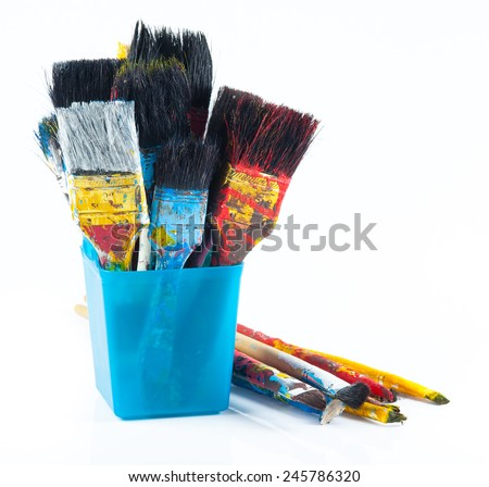 Used artist paintbrushes in a jar. - stock photo