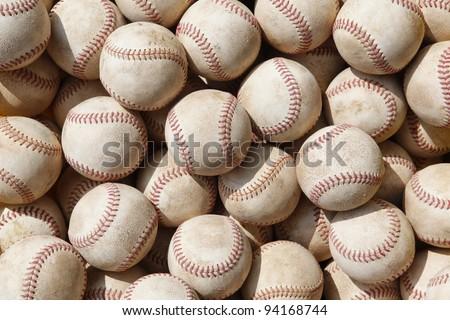 Used baseballs in rows. - stock photo