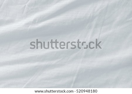 Used bed sheets texture, clean white crumpled cotton material surface.