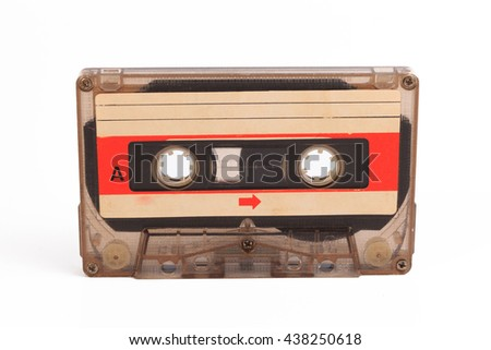Used cassette tape. Vintage audio cassette tap on white background. Old cassette tape audio isolated on white. Old compact audio cassette tape close up shot on white background. Music concept