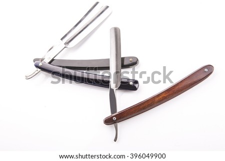 Used Classic Straight Razor, old style, in soft diffuse light. - stock photo