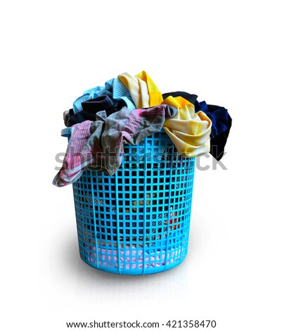 used clothes in plastic basket wait for washing - stock photo