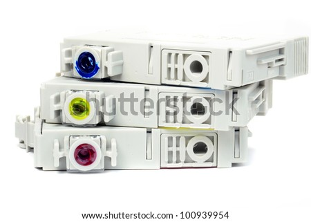 Used coloured ink printer cartridges on a white background - stock photo