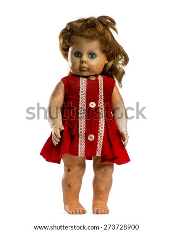 Used dressed doll  in front of a white background - stock photo