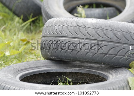 Used, dumped car tyres. Copy space. - stock photo