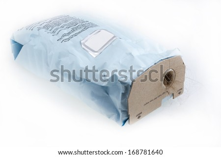 Used full vacuum cleaner disposable bag with dirt sticking out . - stock photo