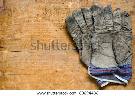 used gloves on wooden background