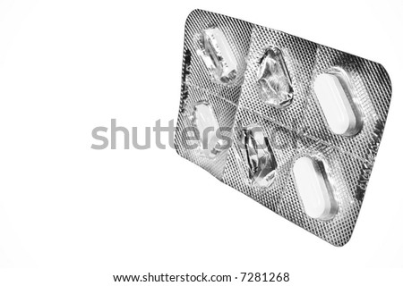 Used medicine tablet blister-pack isolated against a white background.