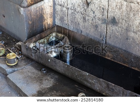 used oil engine basin - stock photo