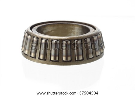 Used old metal bearing on white background - stock photo