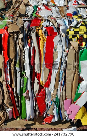 Used paper and cardboard compressed for recycling - stock photo