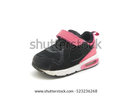 Used pink - black shoe for kids isolated on white background.