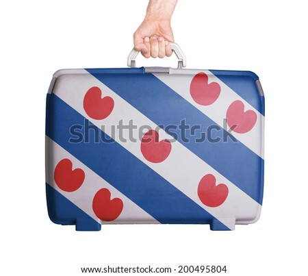 Used plastic suitcase with stains and scratches, printed with flag, Friesland - stock photo
