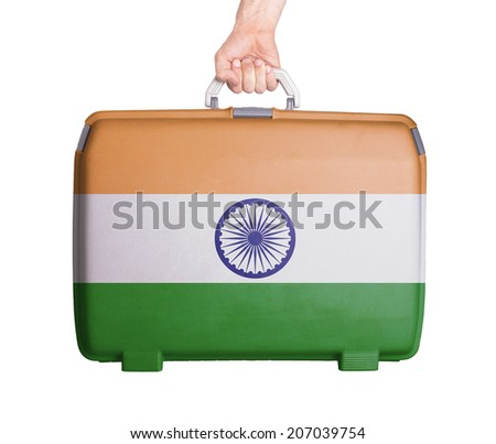 Used plastic suitcase with stains and scratches, printed with flag, India - stock photo