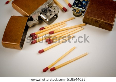 Used retro lighter and matches in a studio shot still life
