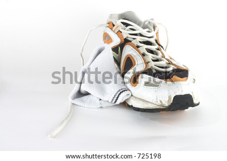 Used sport trainers and socks isolated on white background
