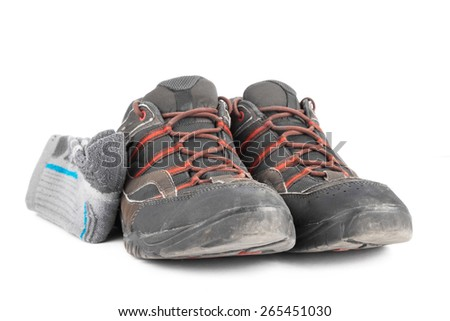 Used summer hiking shoes with hiking socks isolated on white background. - stock photo