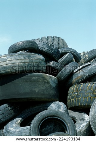 Used tires in a heap - stock photo