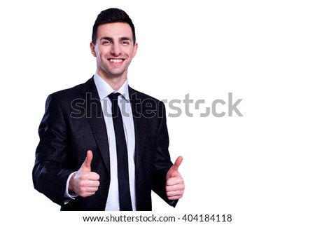 Used to success. Cheerful young man in formal wear showing his thumbs up and smiling while standing against white isolated background - stock photo