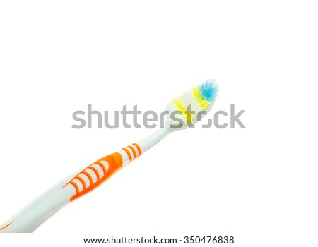 used toothbrush on white background - stock photo