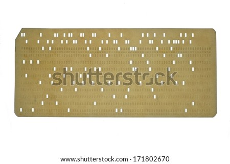 Used vintage punched card isolated on white background, retro technology - stock photo