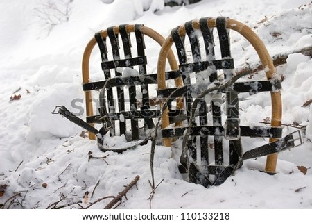 Used Vintage Snowshoes in Snow (detailed view) - stock photo