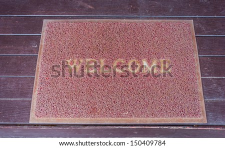 Used welcome carpet mat, welcome doormat carpet on the floor - stock photo