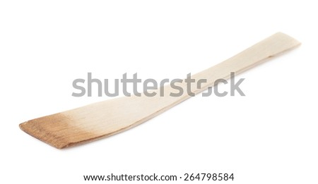 Used wooden spatula food cooking and serving tool isolated over the white background