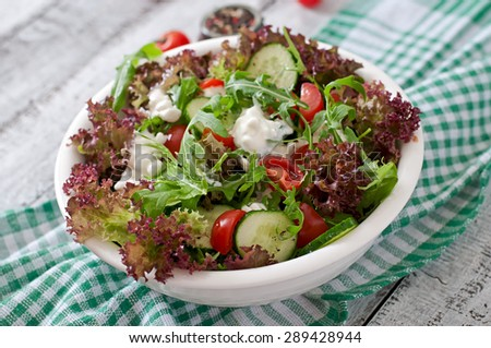 Useful dietary salad with cottage cheese, herbs and vegetables - stock photo
