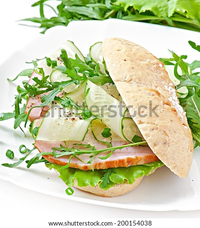 Useful sandwich with ham and herbs