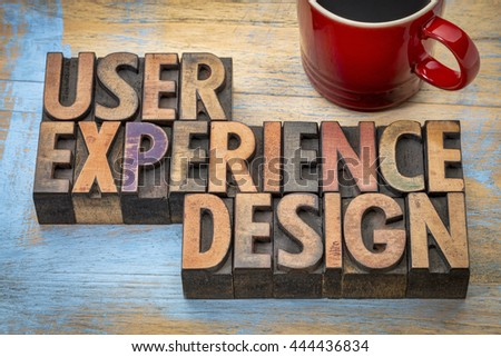 user experience design - word abstract in vintage letterpress wood type with a cup of coffee - stock photo