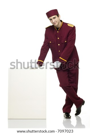 Usher with red uniform and white panel besides him. - stock photo