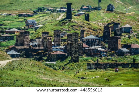 Ushguli, Georgia - July 24, 2015. Characteristic for the entire Svaneti region stone defensive towers in small village Chazhashi, part of Ushguli community in Svaneti region