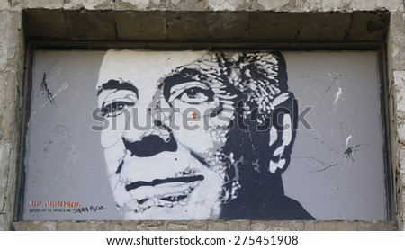 USHUAIA, ARGENTINA - APRIL 2, 2015: Mural art by Jef Aerosol in Ushuaia, Argentina. A mural is any piece of artwork painted or applied directly on a wall, ceiling or other large permanent surface
