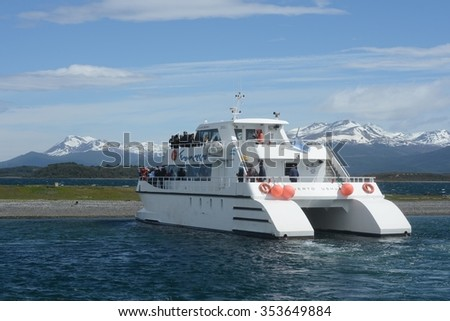 USHUAIA, ARGENTINA - NOVEMBER 16,2014:Marine catamaran in the Beagle Strait.The Beagle channel separating the main island of the archipelago of Tierra del Fuego and lying to the South of the island.