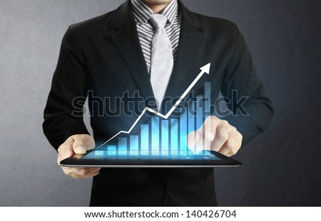usinessmen, hand touch screen graph on a tablet - stock photo