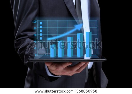usinessmen, hand touch screen graph on a tablet