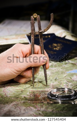 using a compass to measure distance on a map - stock photo