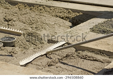 Using a special contract slurry to back fill a sanitary sewer pipe installation during a road re-construction project - stock photo