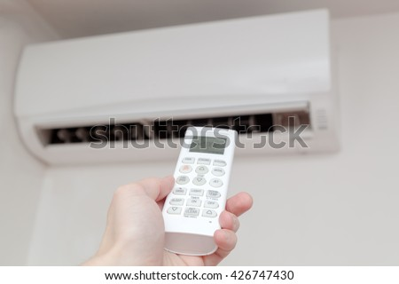 Using air conditioner, remote close up