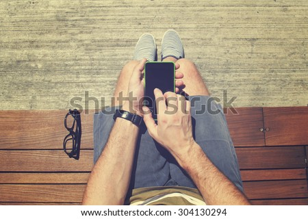 Using cellphone outdoors. - stock photo