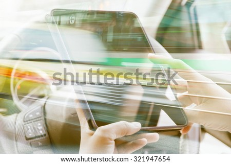 Using digital tablet double exposure and blurred view of car on city street  - stock photo