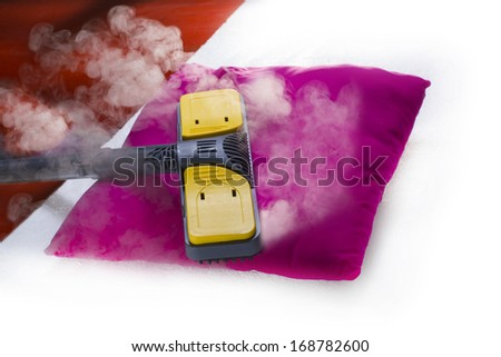 Using dry steam cleaner to sanitize pillow.