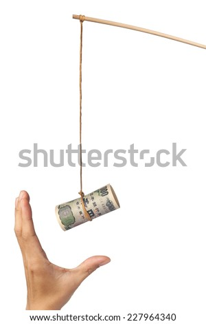 Using Japanese yen as a bait depicting greed, isolated on white background  - stock photo