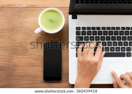 using laptop computer on workspace - stock photo