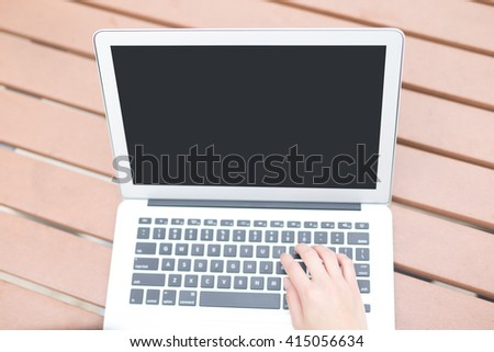 using laptop computer pc on the desk, screen is great for your copy space - stock photo
