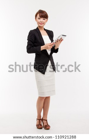 Using pad PC business woman isolated on white background. - stock photo