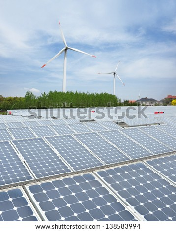 using renewable solar energy with sun and wind turbine