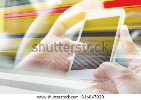 Using smart phone double exposure and blurred view of taxi on city street  - stock photo