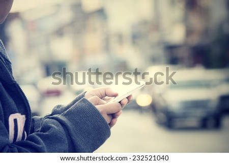 Using smart phone in the street - stock photo